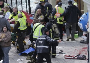 Medical workers aid injured people at the finish line of the 2013 Boston Marathon following an explosion in Boston, Monday, April 15, 2013. (AP Photo/Charles Krupa)