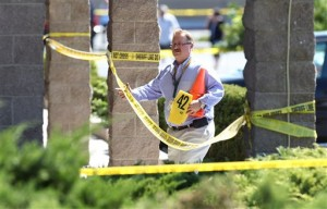 Carson City Sheriff's officials investigate the scene of a shooting in an IHOP restaurant in Carson City, Nev., on Tuesday, Sept. 6, 2011. A gunman with a rifle opened fire at a International House of Pancakes restaurantkilling three people including two uniformed National Guard members and himself, and wounding six others in a hail of gunfire during the morning breakfast hour, authorities and witnesses said. (AP Photo/Cathleen Allison)