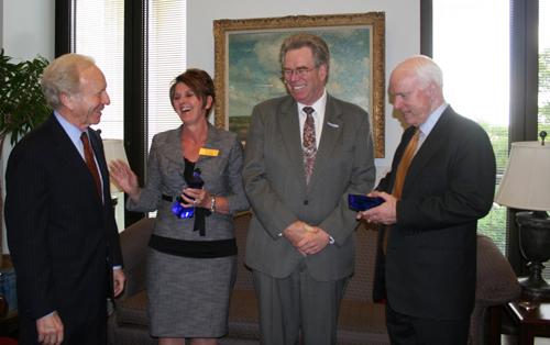 Sen. Joseph I. Lieberman, APCO International 2nd Vice President Gigi Smith, APCO International President Gregg Riddle and John S. McCain