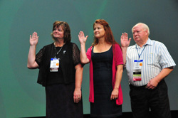 Peggy Fouts, Kimberly Burdick and Don Whitney swore to uphold the APCO International Constitution and Bylaws when taking the oath of office for the Board of Directors on Wednesday, Aug. 22.