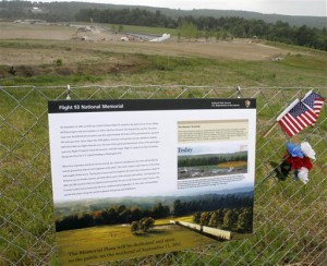 This photo shows a sign describing the plan for the entire Flight 93 memorial on the fence at the temporary memorial as construction continues at the Flight 93 Memorial in Shanksville, Pa. (AP Photo/Keith Srakocic, FILE)
