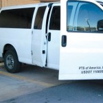 A prisoner transport van is parked in Weatherford Okla., Tuesday Sept. 24, 2013. Eight inmates being transported by a private prison company escaped in the transport van in western Oklahoma on Tuesday. (AP Photo/Weatherford Daily News)