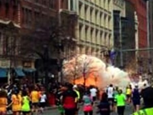 In this image from video provided by WBZ TV, spectators and runners run from what was described as twin explosions that shook the finish line of the Boston Marathon, Monday, April 15, 2013, in Boston. Two explosions shattered the euphoria of the Boston Marathon finish line on Monday, sending authorities out on the course to carry off the injured while the stragglers were rerouted away from the smoking site of the blasts. (AP Photo/WBZTV)