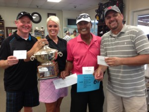 The winning team with a 61 – Mike Mathieu, Tina Scarlett, Kennison Tejada and Brian Dunkle.