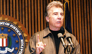 John Walsh gives his remarks during one of many Department of Justice Press Conferences.